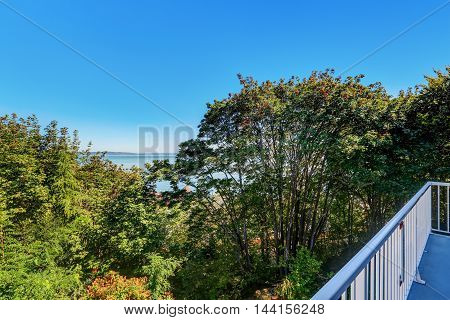 Apartment Balcony With Blue Metal Railings. Water View.