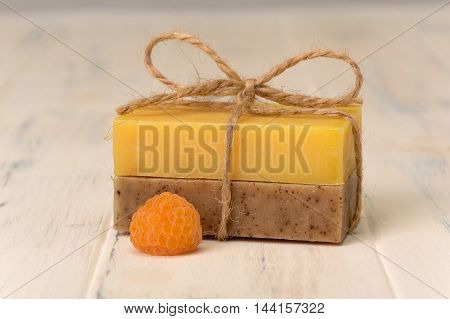 Two bar of soap and one yellow berry raspberry