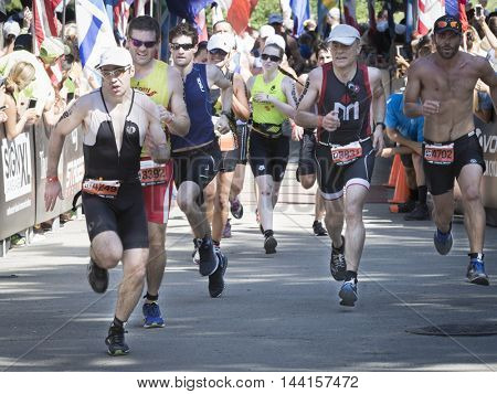 NEW YORK JUL 24 2016: Athletes approach the finish line of the NYC Triathlon Race in Central Park. The run is 10 kilometers and the race is the only International Distance triathlon in the city.