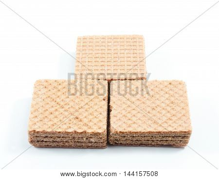 Pile of chocolate wafers on white background.