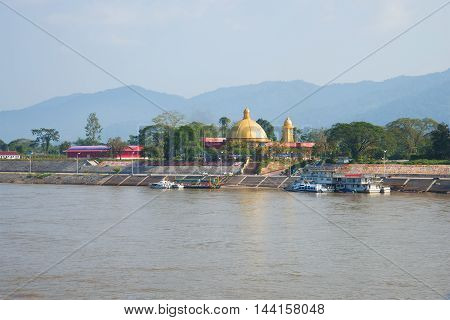 SIBOUHEUANG LAOS - JANUARY 13 2014: Buddhist temple on the banks of the Mekong river. Free economic zone
