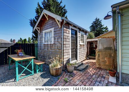 Small Shed In The Back Yard Of American Rambler House