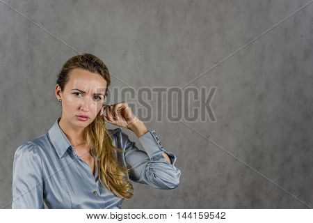 Girl looks forward action on a gray background
