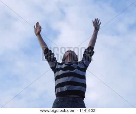 Teenage Boy Reaching For The Sky