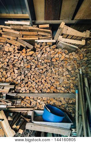 View of a lot of firewood indoor
