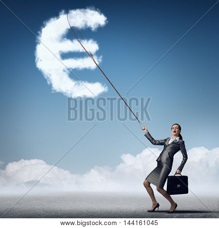 Attractive businesswoman holding on lead cloud euro currency symbol