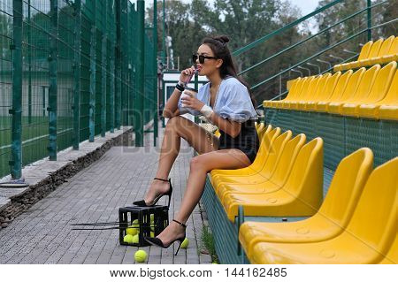Woman Is Drinking A Latte From The Tube