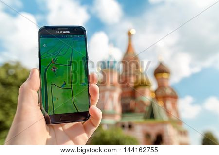 Russia, Moscow, Red Square - August 22: 2016 Smartphone with Pokemon Go application. An Android user plays Pokemon Go, a augmented reality mobile game developed by Niantic for Smartphone