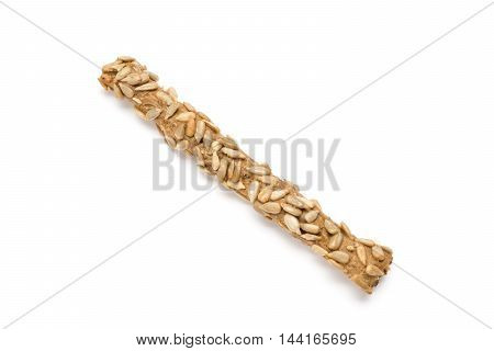 Breadstick with sunflower seeds isolated on white background