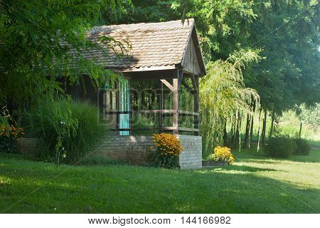 Beautiful old wooden cabin in nature, in front of forest