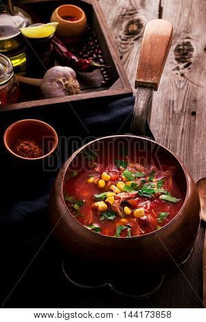 Tomatoe Mexican Soup With Spices On Wooden Table.