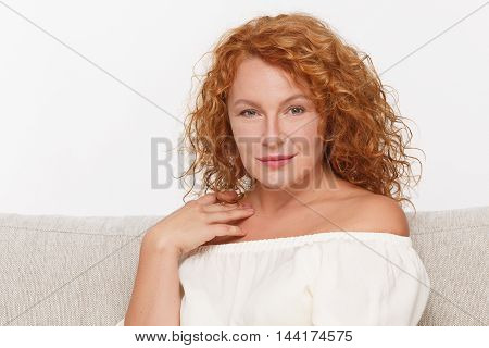 Portrait of seductive or temping mature woman isolated on white background. Beautiful lady looking at camera and smiling. Emotions concept.
