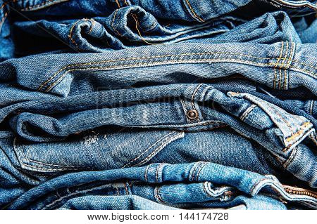Stack of jeans, Background fashion jeans close up