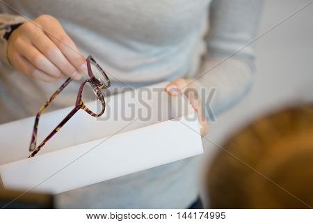 Woman trying on sunglasses in a shop