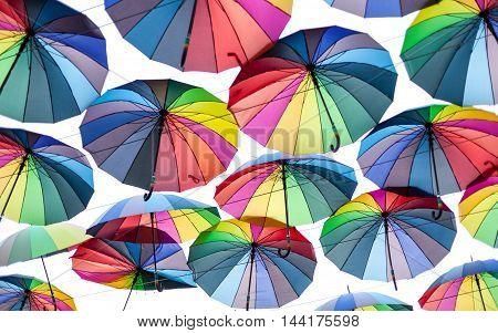 Colorful umbrellas is seen in Odessa city Ukraine. Street decoration. Umbrellas in the sky. Rainbow umbrellas.