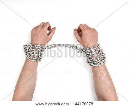 Close up view of chained man's hands. Fetter and captivity. Lack of freedom.