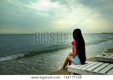 girl with long dark hair on the Black Sea coast cool summer evening