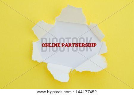 Online Partnership word written under torn paper.