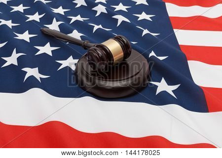 Studio Close Up Shot Of A Judge Gavel Over Flag Of United States Of America