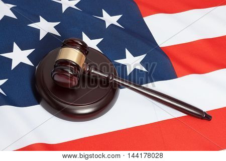 Studio Close Up Shot Of A Judge Gavel Over Flag Of United States