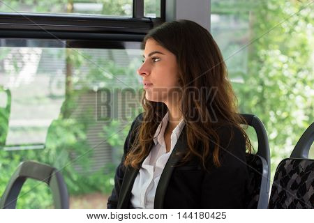 Photo Of Contemplated Young Businesswoman Traveling By Bus