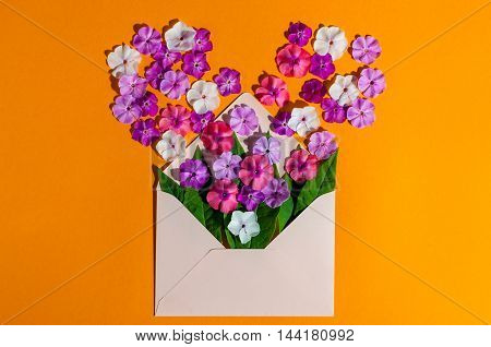 Letter love. Romantic envelope with flowers on the table. Declaration of love feelings. Top view. Empty space for text.