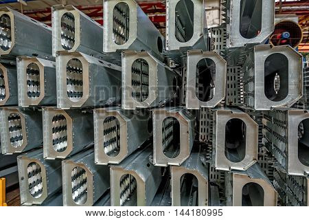 Spare parts of grain harvester at workshop in a plant that manufactures agricultural equipment