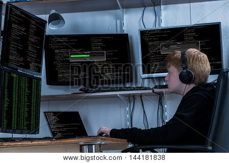 Boy Listening To Music While Stealing Data From Multiple Computers