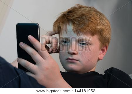 Close-up Photo Of A Boy Using Cellphone