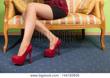 Closeup of sexy girl legs wearing high heels shoes. Woman fashion.