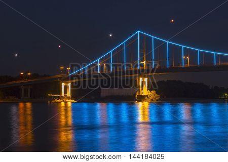 A part of the lit Trukhaniv Bridge in the evening Kiev Ukraine