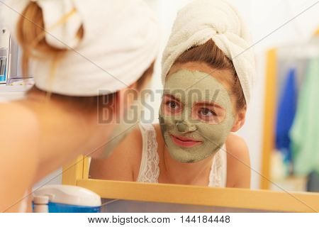 Woman Face With Green Clay Mud Mask