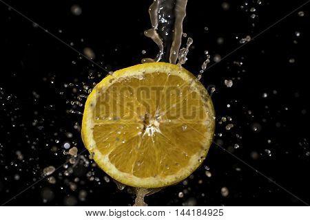 Orange and water splash on a black background.