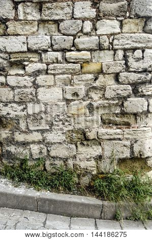 Historical Buildings knit worn stone wall. Background