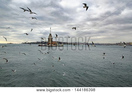 Maidens Tower in Istanbul. European part of Istanbul in the background against the shore. Left Blue Mosque medium Hagia Sophia Topkapi palace dome seem right. The Maiden's Tower (Turkish: Kiz Kulesi) also known as Leander's Tower since the medieval Byzant