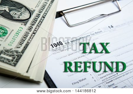american dollars and tax form close up