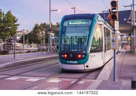 BARCELONA SPAIN - JULY 27 2016: Barcelona at sunset. The tram is going through the Diagonal avenue