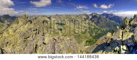 Summer mountain landscape in a panoramic photograph. View of the beautiful valley and ponds in High Tatra Mountains Slovakia.