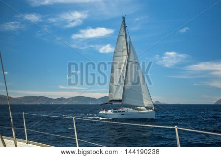 Sailing boats on the waves of the Aegean sea. Yachting in Greece. Luxury Yachts.