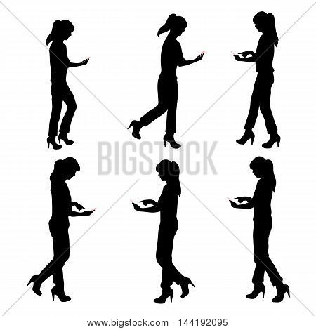 silhouette of woman using a cell phone while walking and play ar game
