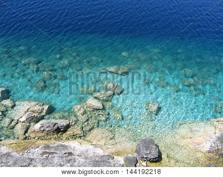 Clear blue water gradient at a lake.
