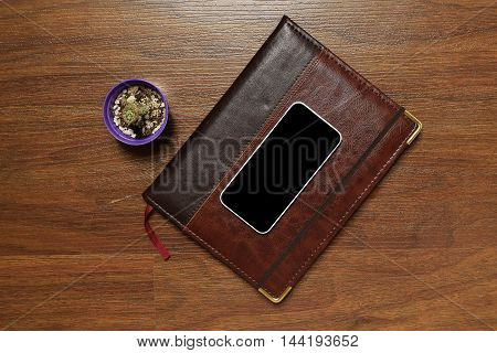 Top View Of Planner And Mobile Phone
