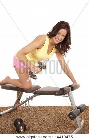 Woman Working With Weights On Bench On Carpet