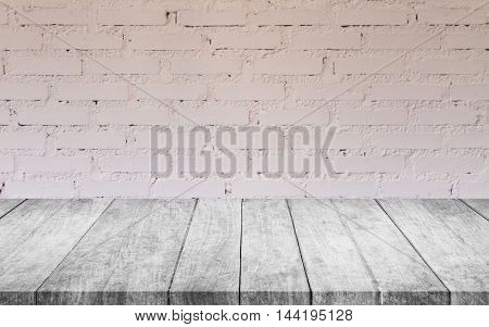 Black and white wooden table top with white brick wall decorated in coffee shop