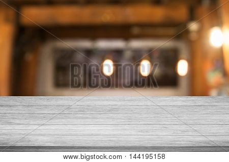 Top of black and white wooden table with coffee shop blurred abstract background