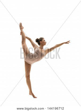 Graceful dancer performs vertical gymnastic split. Isolated on white