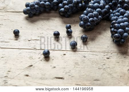 Lots Of Blue Grape Berries On A Wooden Table, Copyspace
