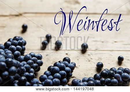 Blue Grapes On Wooden Table, German Word
