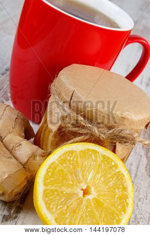 Lemon With Honey, Ginger And Cup Of Tea On Wooden Table, Healthy Nutrition