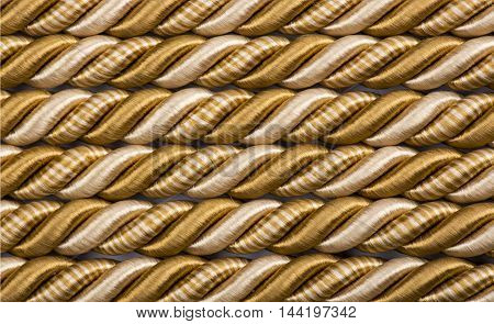 Texture and Background of intertwined threads of gold